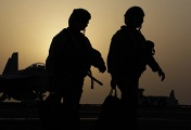 US pilots aboard an aircraft carrier after a flying mission over Iraq