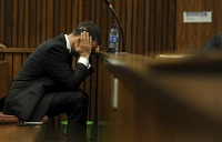 The High Court in Pretoria sentenced South African Paralympic athlete Oscar Pistorius to five years in prison for killing his girlfirend. Oscar Pistorius was earlier found guilty of involuntary manslaughter