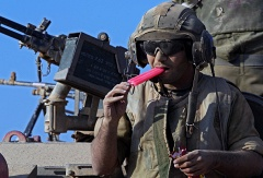 Israeli soldier enjoys his ice cream on top of a Markava tank