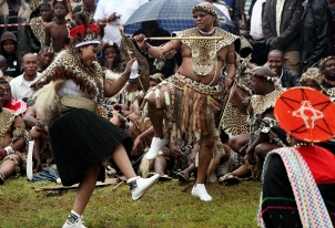 South Africa President Jacob Zuma, right, dances with his newly wedded wife, Thobeka Madiba, left, during a traditional Zulu wedding