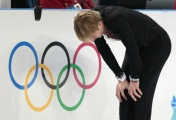 Russian figure skater Evgeni Plushenko quit his sports career ahead of men's short program at the Sochi Olympics after getting his back injured during a pre-contest warm-up