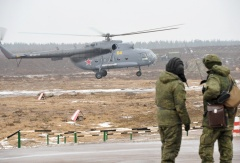 Russian servicemen and a helicopter seen during military drills in the Western Military District