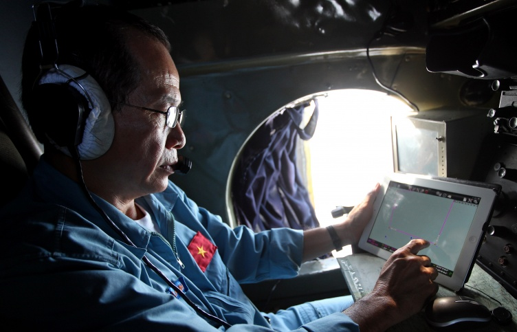 A military official works during search and rescue operations for a missing Malaysian Airlines flight