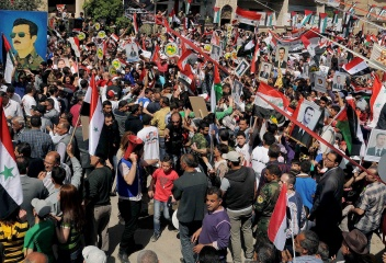 Bashar Assad's supporters rally in Damascus