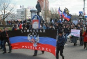 Protesters carry a flag of the self-proclaimed Donetsk's Republic in downtown Donetsk on 05 April 2014