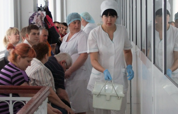 People wait in line to donate blood to the wounded at a hospital in Donetsk