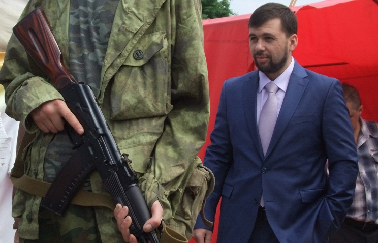 Denis Pushilin (background)
