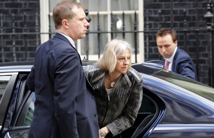 Home Secretary Theresa May (center)